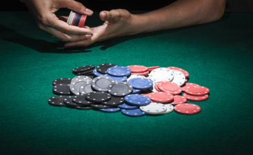 different-poker-chips-on-casino-table_23-2147881549