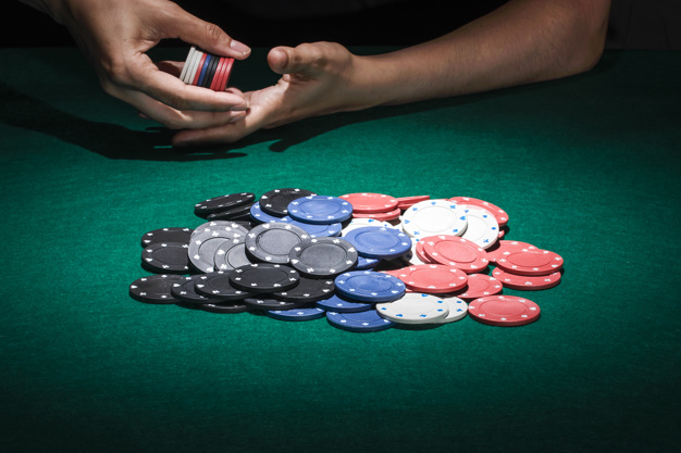 different poker chips on casino table